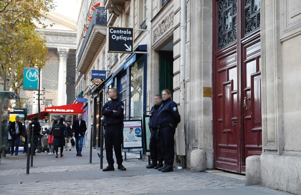 "Police officers stand guard at the entrance to a hotel residence at the Rue Tronchet, near Madeleine, central Paris, on October 3, 2016, where US reality television star Kim Kardashian was robbed at gunpoint by assailants disguised as police who made off with millions, mainly in jewellery. Paris police on October 3 said that the loss amounted to ""several million euros, mostly jewellery,"" adding that they were still assessing the total amount stolen and had opened an investigation. A spokesperson for the celebrity had earlier described her as ""badly shaken but physically unharmed"" after the assault, which occurred late on October 2. / AFP PHOTO / Thomas SAMSON"