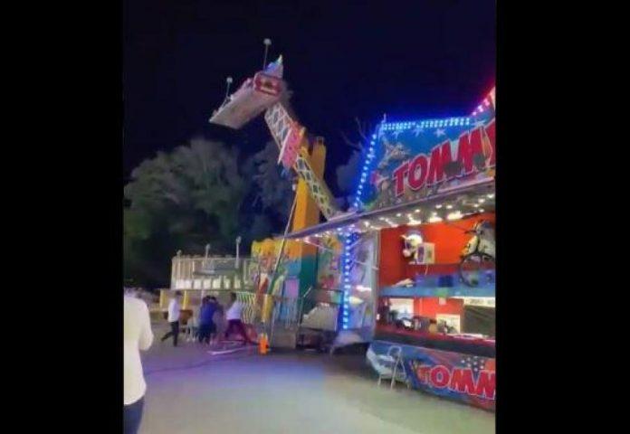 Drame évité à la fête foraine : une attraction manque de s'effondrer, des passants la retiennent (VIDEO)